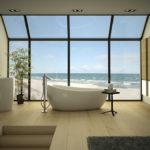 Панорама песчаного пляжа в окне ванной