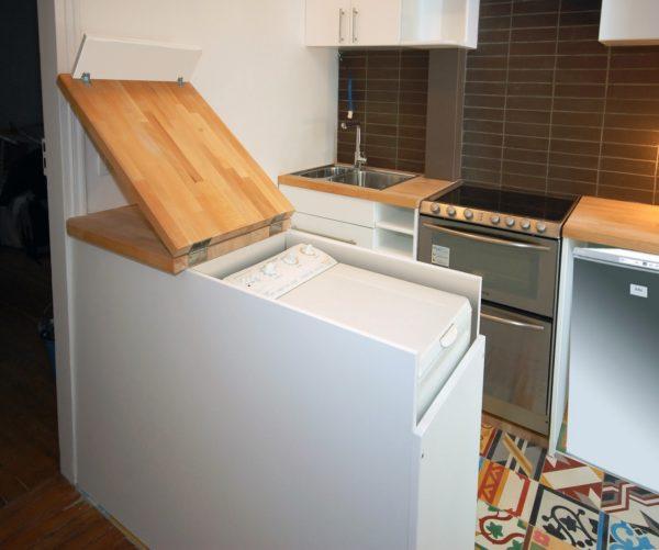 Вертикальная машинка на кухне.
